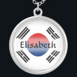 """South Korea Flag   Name Necklace<br><div class=""""desc"""">The design for this attractive pendant features a name overlying the South Korean flag, which has been neatly morphed to fit the round shape. The featured name can be changed to any name or text of your choice, creating a personalized gift for someone who loves South Korea. &#169; 2011 FlagAndMap...</div>"""