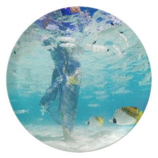 South Pacific, Bora Bora, female tourist walking Plate