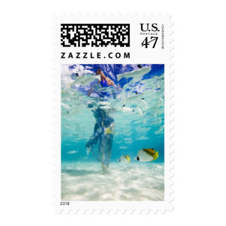 South Pacific, Bora Bora, female tourist walking Postage