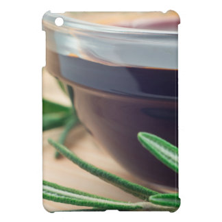 Soy sauce in a glass and a sprig of rosemary case for the iPad mini
