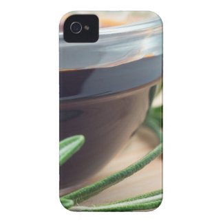 Soy sauce in a glass and a sprig of rosemary iPhone 4 Case-Mate case