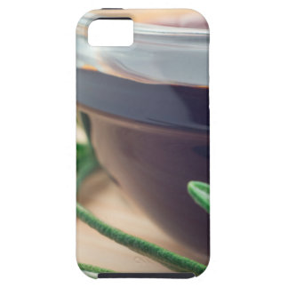 Soy sauce in a glass and a sprig of rosemary iPhone SE/5/5s case