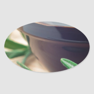Soy sauce in a glass and a sprig of rosemary oval sticker