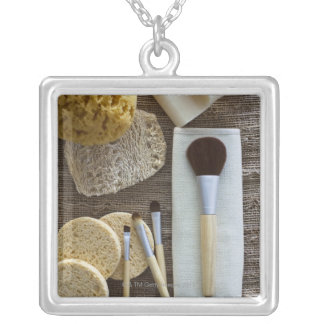 Spa detail of sponges and brushes silver plated necklace