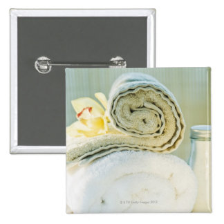 Spa towels and tropical flower pinback button