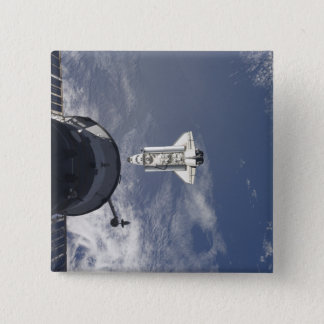 Space Shuttle Atlantis and a Russian spacecraft Button