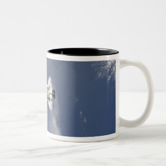 Space Shuttle Atlantis and a Russian spacecraft Two-Tone Coffee Mug