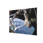 Space Shuttle Atlantis and a Soyuz spacecraft Canvas Print