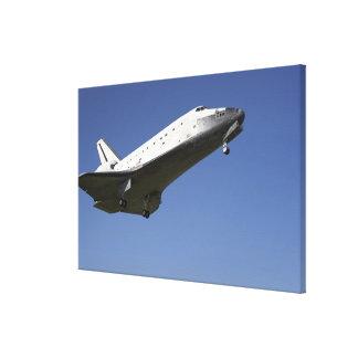Space shuttle Atlantis approaching Runway 33 2 Canvas Print