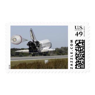 Space shuttle Atlantis unfurls its drag chute 2 Postage