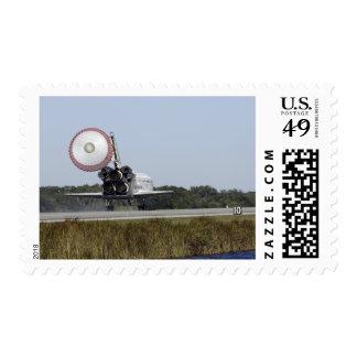 Space shuttle Atlantis unfurls its drag chute 3 Postage Stamps