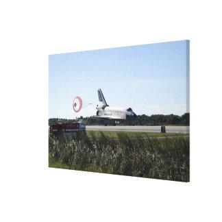 Space shuttle Atlantis unfurls its drag chute Canvas Print