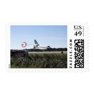 Space shuttle Atlantis unfurls its drag chute Postage Stamp
