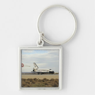 Space Shuttle Discovery deploys its drag chute Keychain