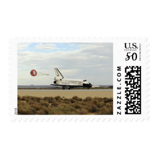 Space Shuttle Discovery deploys its drag chute Postage