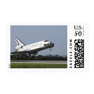 Space shuttle Discovery lands on Runway 33 2 Postage
