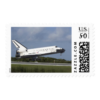 Space shuttle Discovery lands on Runway 33 3 Postage
