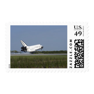 Space shuttle Discovery lands on Runway 33 4 Postage