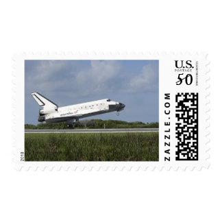 Space shuttle Discovery lands on Runway 33 Postage