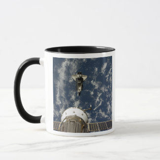 Space Shuttle Endeavour and a Soyuz spacecraft Mug