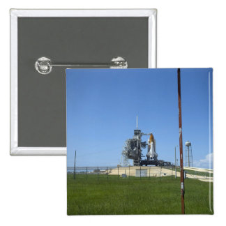 Space shuttle Endeavour is framed by a windsock Button