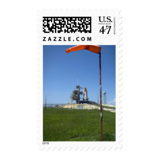 Space shuttle Endeavour is framed by a windsock Postage