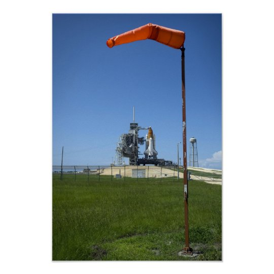 Space shuttle Endeavour is framed by a windsock Poster