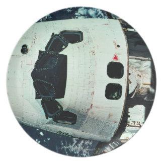 Space Shuttle Orbiting Earth Plate