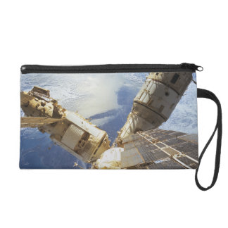 Space Station in Orbit 8 Wristlet Clutches