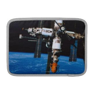 Space Station in Orbit MacBook Sleeve