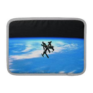 Space Station Orbiting Earth 4 MacBook Sleeves