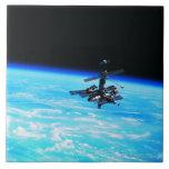 Space Station Orbiting Earth 7 Ceramic Tile