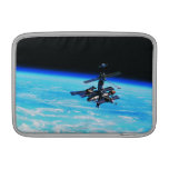 Space Station Orbiting Earth 7 MacBook Sleeves