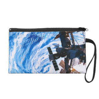 Space Station Orbiting Earth 9 Wristlet Purse