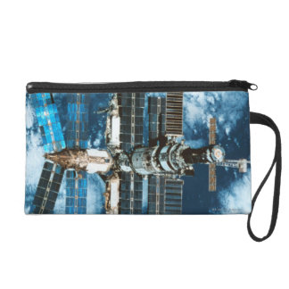 Space Station Orbiting Earth Wristlet Purse
