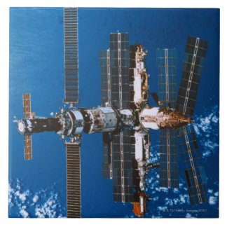 Space Station Orbiting in Space Tile