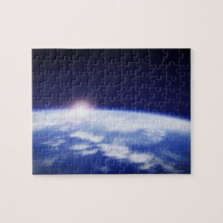 Space with rising sun above planet earth jigsaw puzzle