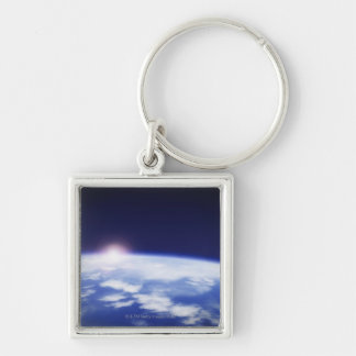 Space with rising sun above planet earth keychain