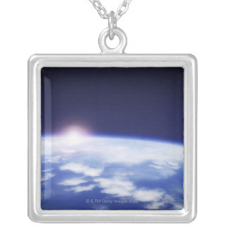 Space with rising sun above planet earth silver plated necklace