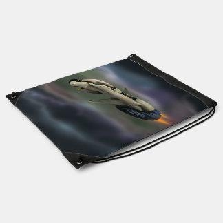 Spacecraft flying through a planet drawstring bag