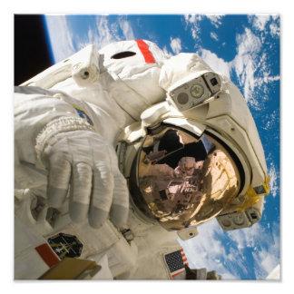 Spacewalk del vendedor de los embarcaderos arte con fotos
