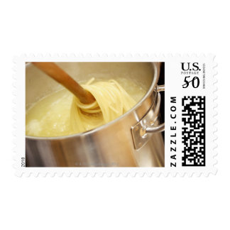Spaghetti Being Stired in Pot Postage