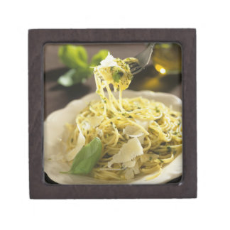 Spaghetti with basil and parmesan on plate, jewelry box