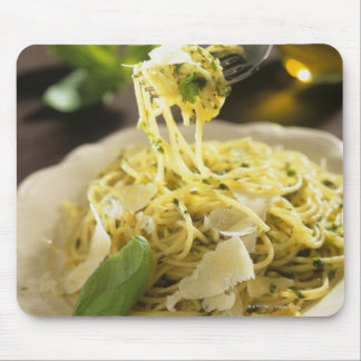 Spaghetti with basil and parmesan on plate, mouse pad