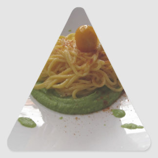 Spaghetti with bottarga on asparagus sauce triangle sticker