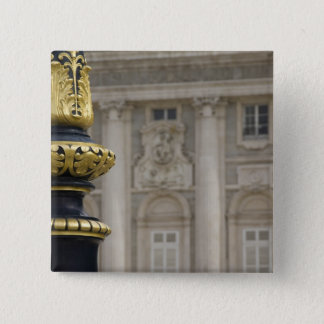 Spain, Madrid. Royal Palace, ornate gilded lamp Button