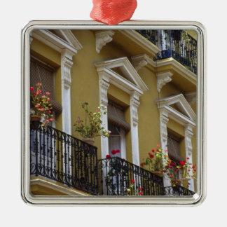 Spain, Sevilla, Andalucia Geraniums hang over Metal Ornament