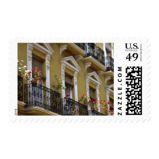 Spain, Sevilla, Andalucia Geraniums hang over Postage