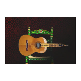 Spanish guitar with Giralda of Seville and chair Canvas Print