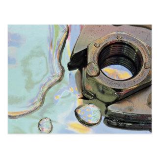 Spanner, nut in oil postcard